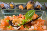 mussel filled with tomato onions and green pepper on platter poster