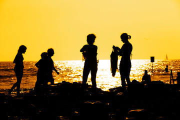 a family on sunset at the beach.