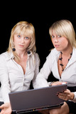 Two businesswomen with laptop. Isolated on black background poster