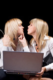 Two kissing businesswomen with laptop. Isolated on black poster