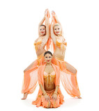three dancers in bright arabian stage costumes poster