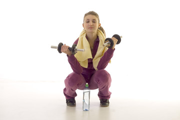 Young brunette girl exercising on the floor isolated