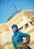 beautiful muslim woman in front of the mosque poster