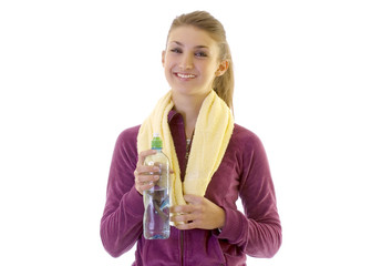 Young brunette girl taking water after exercising