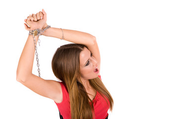 Female locked by metal chain with pain countenance