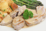 Pork medallions in apple sauce with sauteed potatoes poster