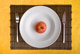 white dish and apple on bamboo board with yellow background poster