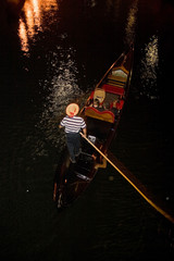 A gondola on the canal at night
