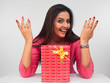 a laughing woman with a gift box