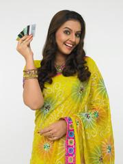 beautiful woman holding a credit card