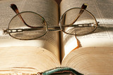 aging book and spectacles for correcting the vision poster