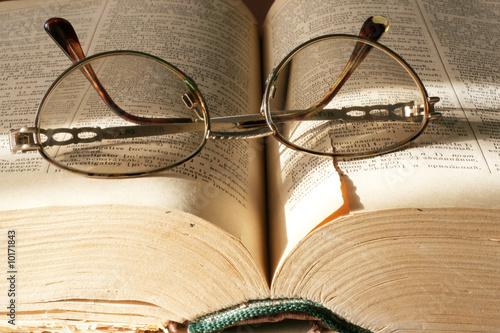 aging book and spectacles for correcting the vision