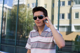 Young brunet with mobile phone poster