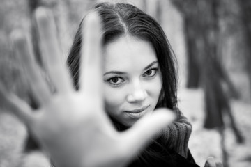 Woman stretching hand to the camera. Black and white concept.