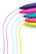 Five colored highlighter pens on white background