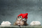 Funny photo of the afraid Santa Claus hidden under the table poster