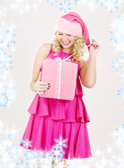 picture of cheerful santa helper girl with gift box
