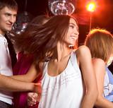 Fototapety Photo of energetic girl dancing in the night club