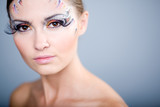 Beautiful fashion make-up with face art and long lashes.