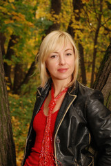 Blond woman in the autumn forest