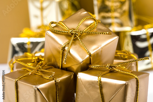 Christmas gifts boxes close up. Golden color boxes