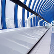 Blue glass corridor in office centre