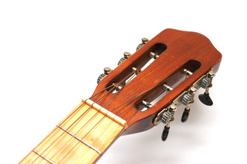 Fingerboard of old guitar on white