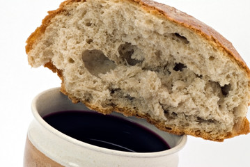 Red wine and bread - communion on the white background