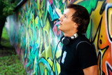 DJ Roman Kravtsov standing at the graffiti wall