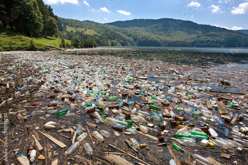 Leinwanddruck Bild very important plastic and trash pollution on beautiful lake