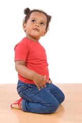 Adorable african baby kneel down over wooden floor
