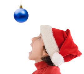 Boy looking at ball of Christmas on a over white background