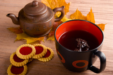 Cup of hot tea with cakes.