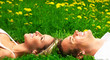 Young love couple sleeping on green grass.