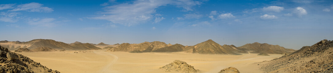 Panorama of desert and hills with blue sky