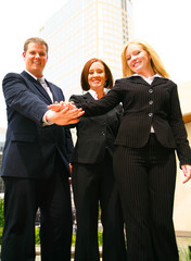 three successful happy businesspeople as team