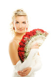 Beautiful young bride with luxury bouquet of red roses