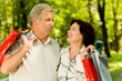 Senior attractive happy smiling couple with shopping bags