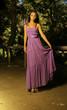model wearing purple flowing dress