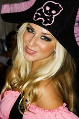 Blond girl in pirate costume on Helloween party