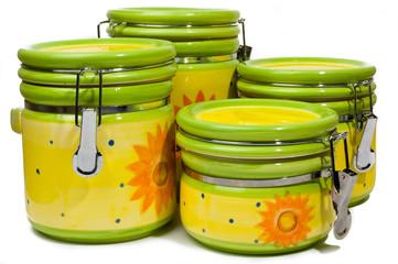 A set of four handmade, colorful ceramic storages