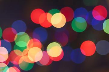 blurred motley garland lights group on dark background