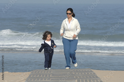 mother and is daughter running at the beach
