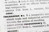 A close up of the word recession from a dictionary poster
