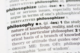 A close up of the word philosophy from a dictionary poster