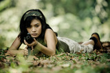 beautiful female soldier aiming machine gun