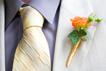 Orange Rose Wedding Boutonniere On Suit of Groom