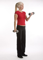Middle-agred woman working out with weights