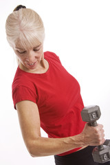 Middle-aged woman working out with weights