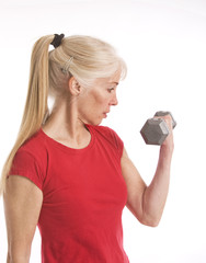 Middle-aged woman lifting small barbell